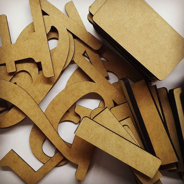 Assembling wooden table numbers for a wedding.