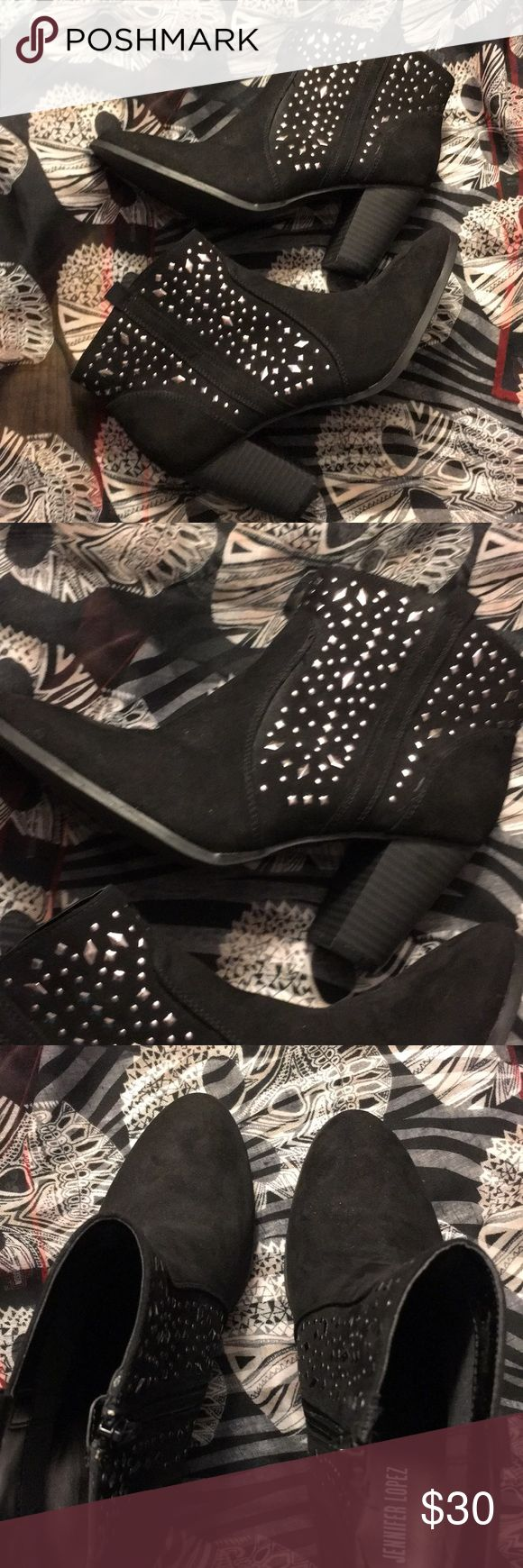 """Jennifer Lopez. Size 8.5"""". New. Sassy J-lo bootie with size sides and silver studded detail. Size is 8.5"""" and heel height approximately 3"""". New without tags. Jennifer Lopez Shoes"""