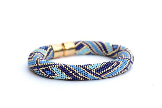 This bead crochet bracelet is made of really tiny Japanese seed beads Toho #15 of superior quality. I used modern geometrical pattern and rich colors