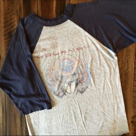 1981 Journey Tour Raglan Still not sure if I want to sell this one, price firm for now. Authentic Journey concert tee, raglan/baseball style, super soft & thin! Seen on Freaks & Geeks!  BRAND: - MATERIAL: 50/50 YEAR/ERA: 1981 LABEL SIZE: L BEST FIT: M  MEASUREMENTS: Chest 19 inches  Length 26-28 inches rounded hem   Trades  Modeling  Check out my closet for more vintage tees! Vintage Tops Tees - Long Sleeve
