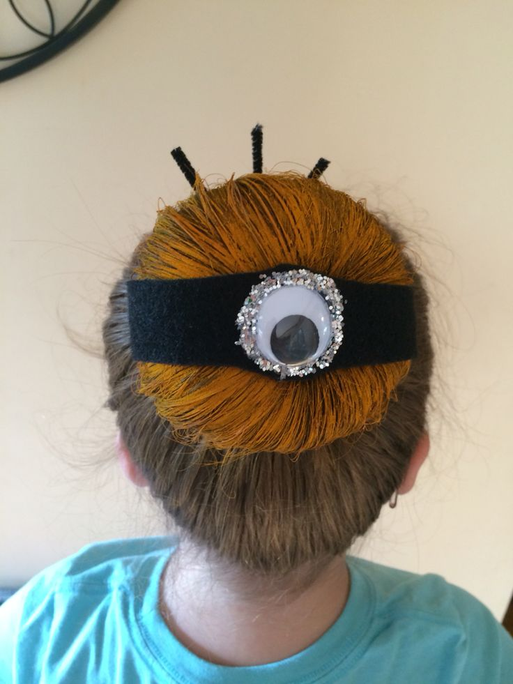 Minion bun for crazy hair day! 1. Sock bun 2. Yellow hair spray 3. Black felt with eye attached. Some glitter for goggle and I put bobby pins on the end of felt to stick it in the bun.