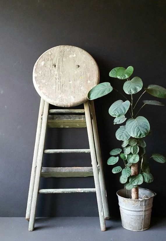 Vintage painters step ladder, solid wood folding step stool. Darling pale green farmhouse 2 step ladder. Strong and sturdy, Metal hinges, hard wood. In great vintage condition. Beautiful patina due to age and use.  Measures: When Folded - 32 tall X 14 wide X 6 deep. When open : 24 tall X 21 wide X 14 deep Seat - 12 in diameter  Use it as a display for your plants. side table. riser for electric fan, kitchen laddet, or a seat... The possibilities are endless ...  ** More photos are available…