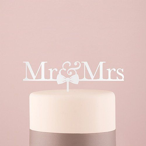 """Express your newlywed status on top of your cake with this classic """"Mr & Mrs"""" cake topper. The addition of an adorable bow tie adds a hint of whimsy to this otherwise traditional design. Simply place"""