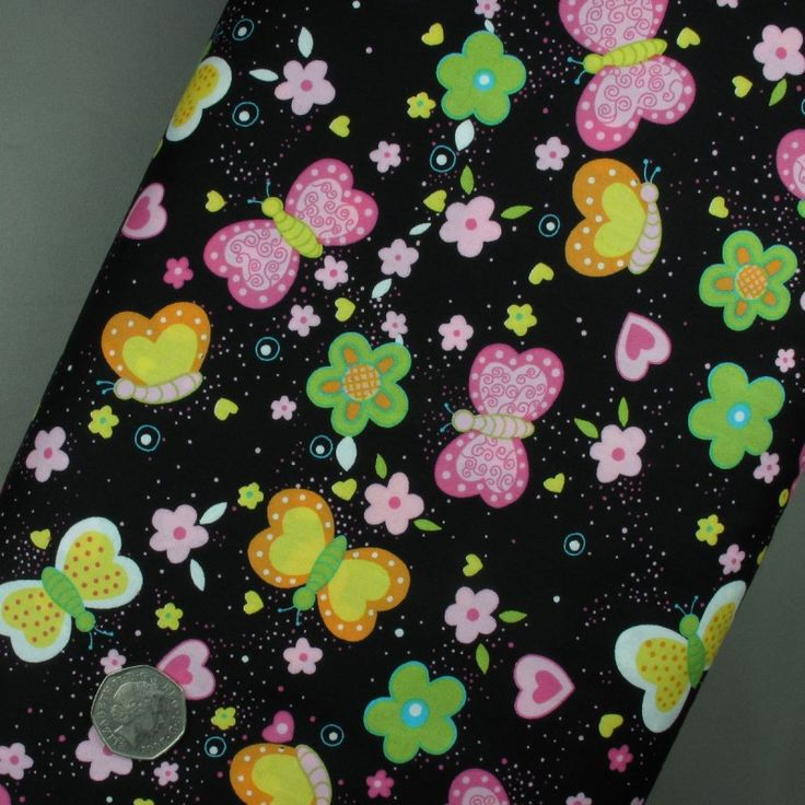 Butterflies, Hearts and Flowers on Black fabric 100% cotton - sold per metre