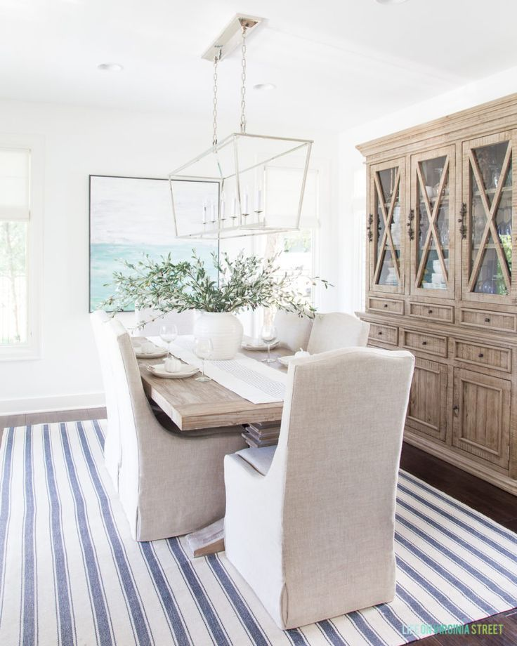 A coastal dining room with a striped