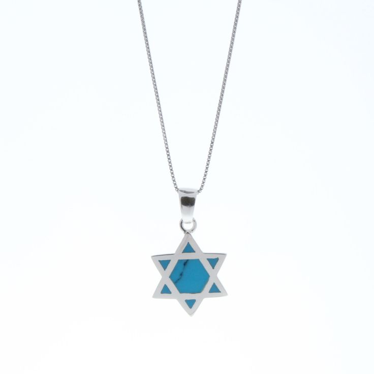 Handcrafted 925 Sterling Silver Star of David pendant necklace. A graceful creation featuring a delicate silver chain, adorned with a magnificent silver Star of David set with beautiful manmade Turquoise  triangles, showcasing a silver Star of David displaying a soft antique finish. This singular piece of jewelry is proof tradition and style can go together. Complete the look with a fabulous blue opal silver statement ring.