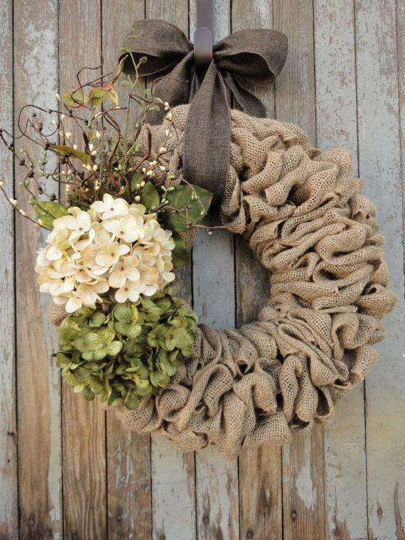 Beautiful earth-tone Easter wreath. Cream and green hydrangea flowers are perfectly coordinated with cream, green, and brown pip berries, greenery, and curly willow twigs. Hangs by either a brown or moss green faux burlap ribbon. Our beautiful wreaths make unique gifts for weddings, birthdays, Christmas, and Mothers Day. This wreath is made in either an 18 or 22 wreath. You are able to choose wreath size and ribbon color from the drop down boxes at time of checkout.  18 - $65.00 22 - $85.00…