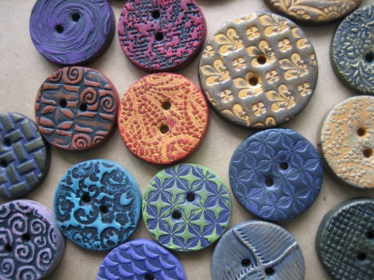 "Spring 2010 and the buttons are blooming!  Friend Alan Sasaki shared his ""Clay Squishers"" and I was off and running!  Decided to blend poly..."