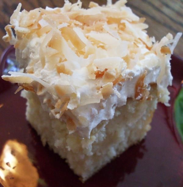 coconut poke cake... Also try with chocolate cake mix and add chopped almonds on top for an Almond Joy poke cake.