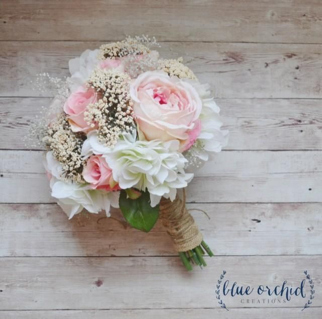 This high quality silk wedding bouquet is absolutely gorgeous!  Pink roses and garden roses are mixed with cream hydrangea, queen anne's lace, and dried baby's breath. This rustic, silk flower bouquet is beautiful. Shown wrapped in burlap and twine, this wedding bouquet is about 10-12