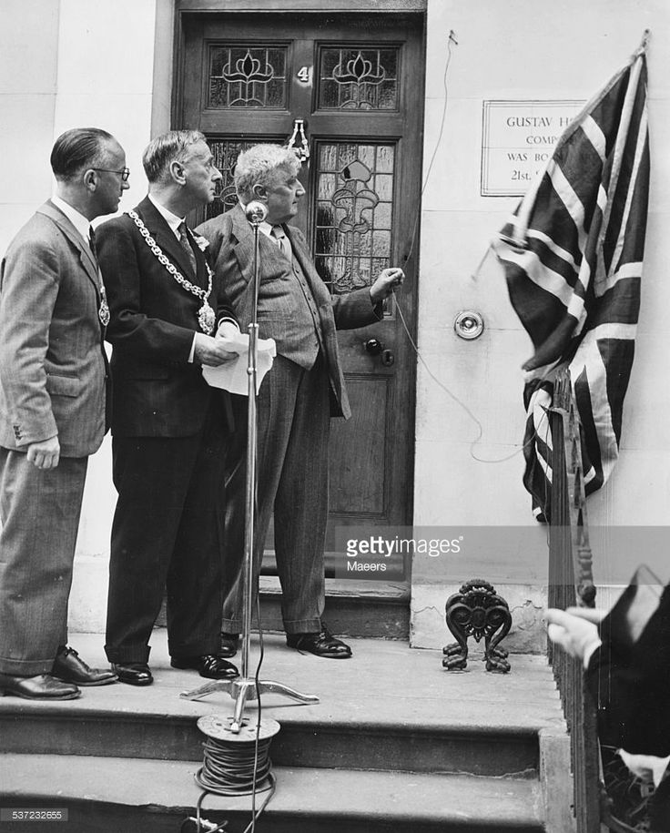Composer Ralph Vaughan Williams and the Mayor of Cheltenham, unveiling a plaque at the house where Gustav Holst lived, as part of the Cheltenham Music Festival, July 4th 1949.