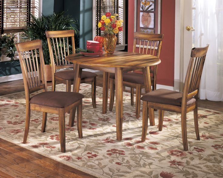 Berringer Round Dining Room Drop Leaf Table 4 UPH Side Chairs By Ashley Furniture Get Your