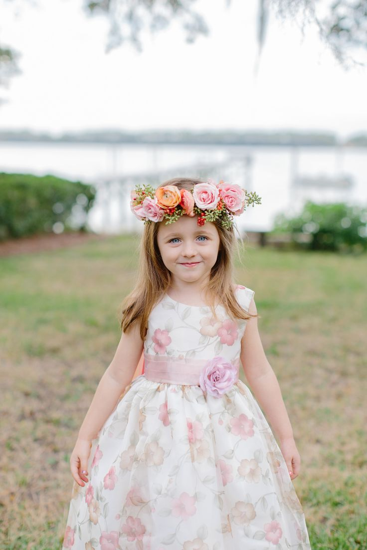 Sweet flower girl in a floral #crown | Photography: Shannon Michele Photography - shannonmichelephotography.com/  Read More: http://www.stylemepretty.com/2014/04/23/pink-peach-backyard-charleston-wedding/