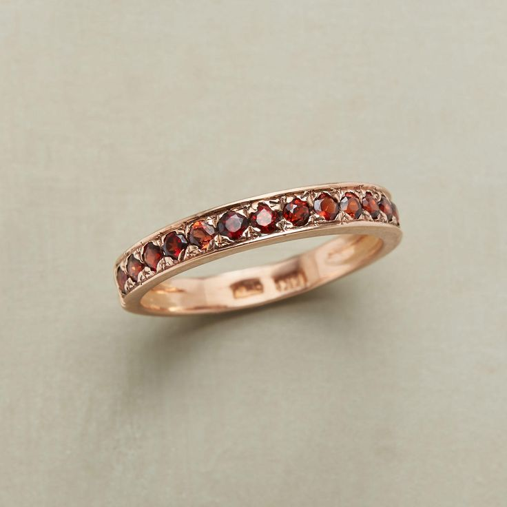 Ring of Roses Band: These glowing garnets, that span her finger, will last  foreve. Romantically set in a band of rose gold. Designed by Arik Kastan.