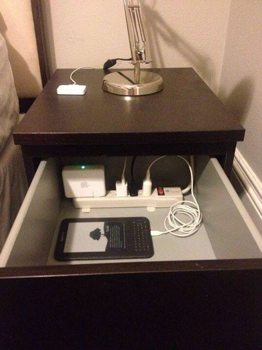 Run cord through the back of your night stand to keep your electronics organized!!