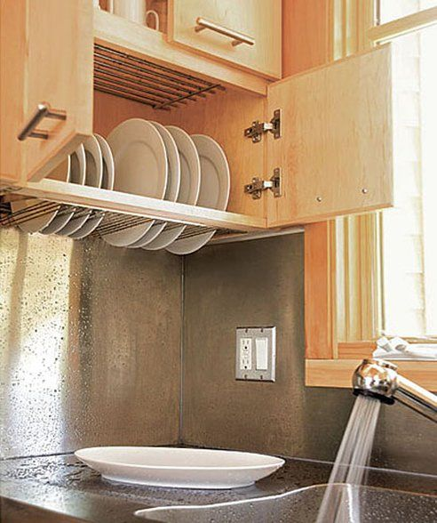 Dish-drying cabinet over the sink. Genius. Would love this in any house!