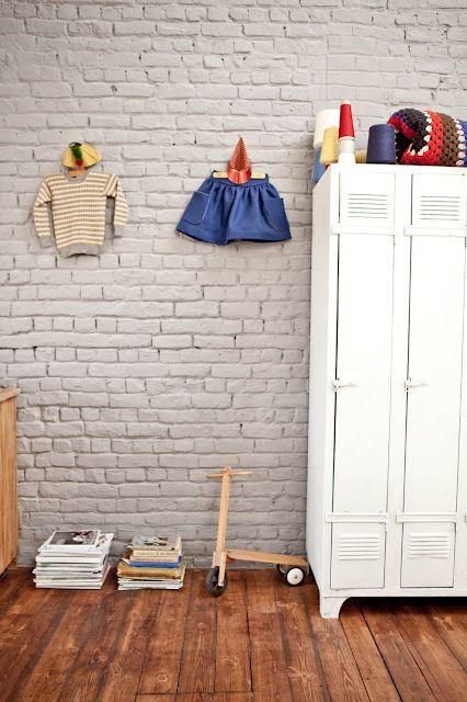 mudroom storage. white brick. wood floor. white lockers.