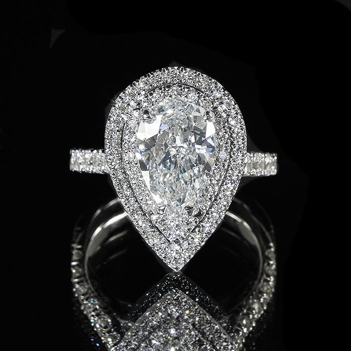 Pear Shape Double Halo Diamond Ring set in White Gold with a Single Row #engagement #wedding #ring