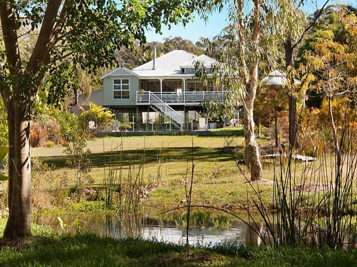 back of a Queenslander house with deck and bedroom extention
