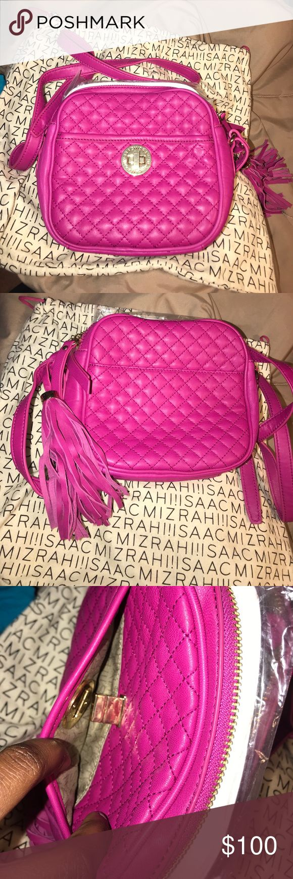 Isaac Mizrahi Bridgehampton Quilted Leather Bag Isaac Mizrahi Live! Bridgehampton Quilted Leather Camera Bag in Bright Berry. 100% Leather / Lining 80% Polyester 20% Cotton Tassel Detail/ Chrome Lick Closure/ Adjustable Crossbody strap Back and front slip pockets/Double top zipper closure Logo Lining /Two Compartments From QVC bag was bought at $160 and is on the website being sold for $110 Isaac Mizrahi Bags Crossbody Bags
