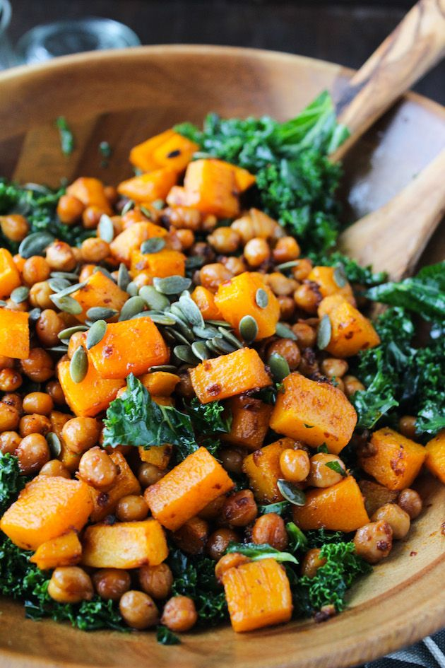 Chipotle roasted chickpeas and butternut squash salad over a bed of massaged kale and topped with a handful of pumpkin seeds. Enjoy warm or cold