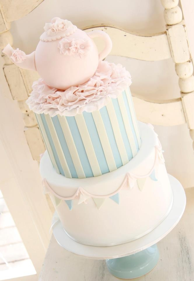 I love the bottom two tiers . This in punk and maybe yellow Would be gorgeous with fresh flowers