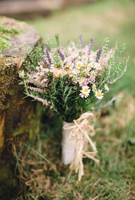 Brides.com: . Perfect for bridesmaids, this petite bouquet featuring lavender and sprigs of rosemary is just the thing for a backyard summertime soirée.