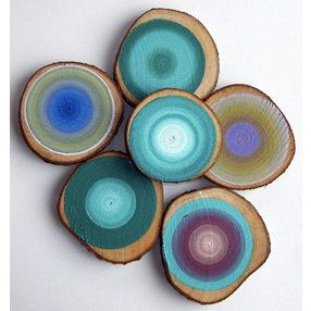 Painted tree stump slices.  Then hang them on the wall...sweet!