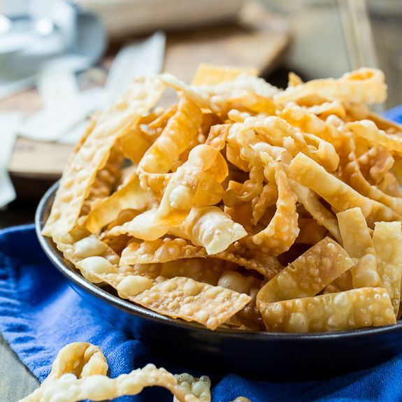 Only 2 ingredients needed to make these crunchy Fried Wonton Strips. Eat them plain or use them for some crunch on a salad.