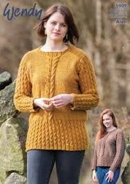 Wendy 5909 Twist Stitch and Cable Tunic and Sweater in Wendy Cairn Aran (#4) weight yarn. For adults in several sizes.