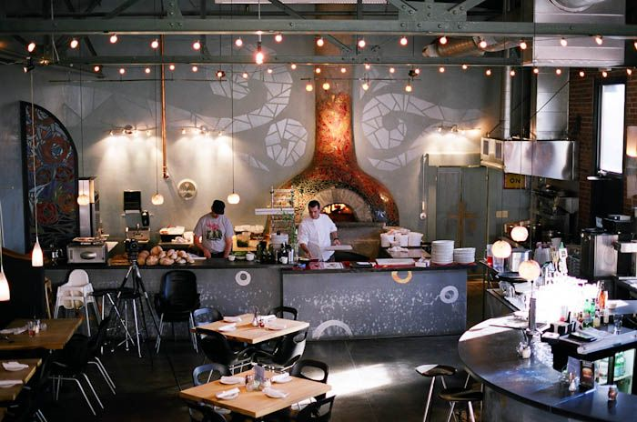 West First Wood Fired  is on First Avenue West one half of a block off of Main Street Downtown.  This restaurant has a ceramic pizza oven that is a piece of art and so are the desserts.  The old brick walls and the metal stairway give this restaurant a wonderfully urban feel.