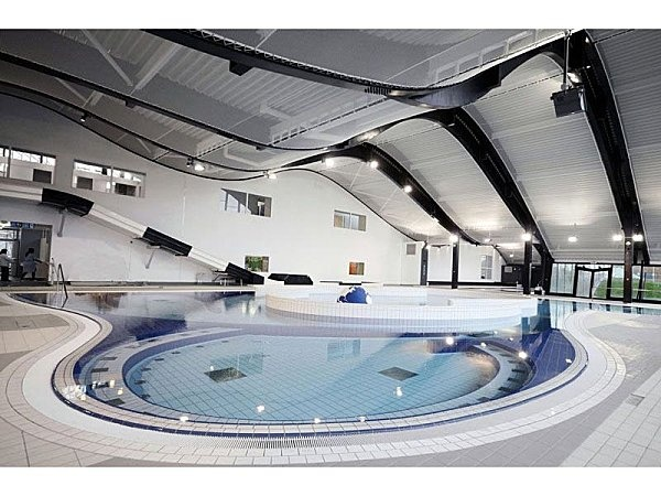 Pôle Nautique Mantes la Jolie - agence Search - tensioned ceiling made with Batyline XP55 open work membrane
