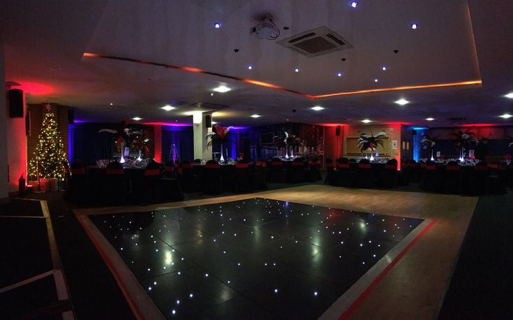 Fairy-lit dancefloor, with Christmas tree in the background