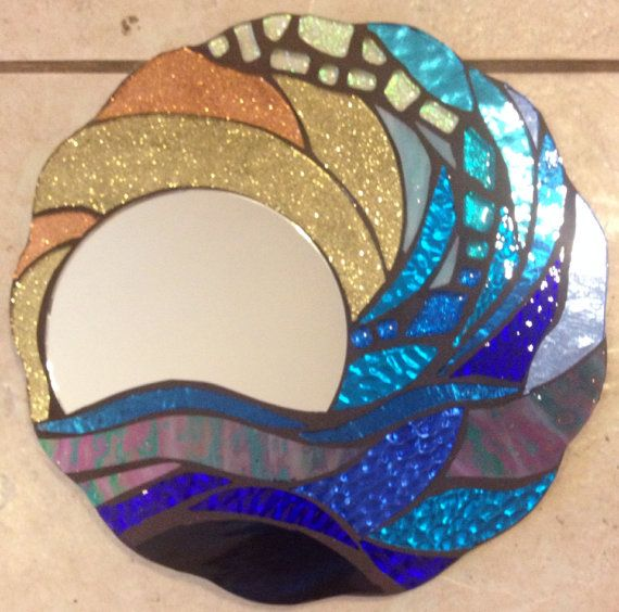 """This is an all hand cut, handmade mosaic Wall Hanging. It is a beach motif mosaic using stained glass, glitter glass, mirror glass and several other materials in a variety of colors. This is a unique item, and really sparkles! . I had a lot of fun making this...and would be a beautiful addition to any decor. It is 10"""" in Diameter and weighs appx. 3 lbs. It is grouted in Charcoal gray."""