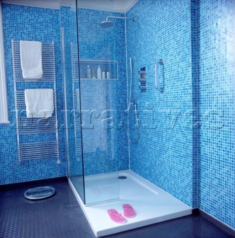 walk in shower in modern blue mosaic bathroom