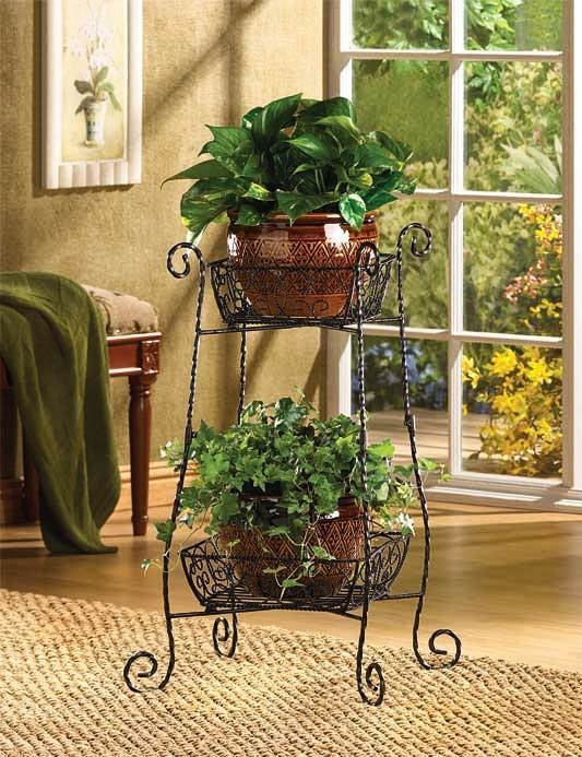 10159bb263f8 wrought iron plant stand | How pretty! | Black plant stand, Metal plant  stand, Plant shelves