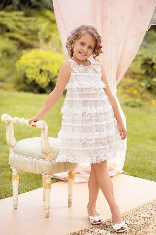 Layers of mixed lace make this sweet dress stand out. #papiliokids #flowergirl #whitedress #kidsfashion #weddingfashion #wedding #girlsfashion #girl #dress #lace #lacedress