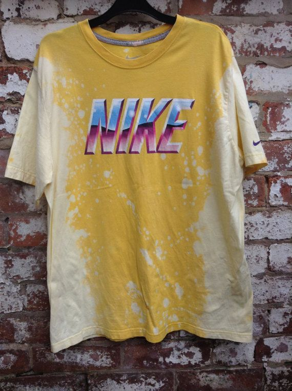 Distressed bleached acid wash retro nike tee. Vintage 90s hip hop and grunge style.