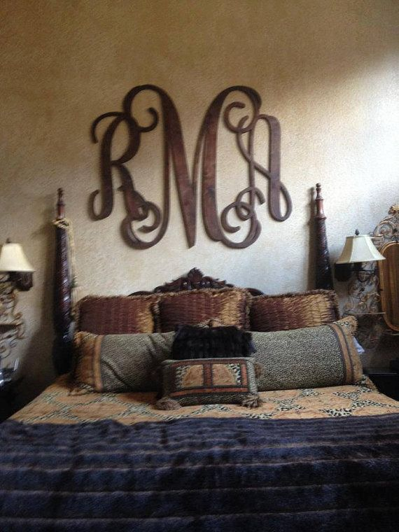 Love this monogram over the bed
