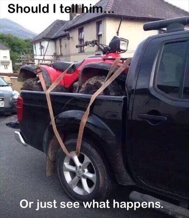 Funny Pictures Of The Day - 42 Pics   I'm sure the tie down strap through the tire of his truck should not impede his travel at all........