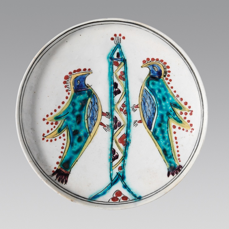 Plate (Second half of the 18th Century) Everted plain rim, slightly concave body, ring base. White paste, white slip, transparent glaze. Underglaze decoration in cobalt blue, turquoise, dark green, yellow, manganese purple and brownish red, with black outlines.