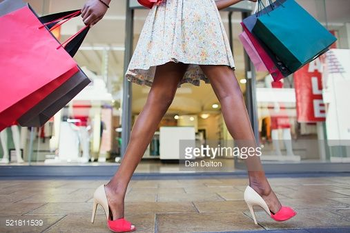 Stock Photo : Woman carrying shopping bags in shopping mall