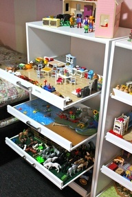 Repurpose old dressers for play stations for children.  Take the front & sides off, put on roller pull-outs with handles and add their favorite playsets.