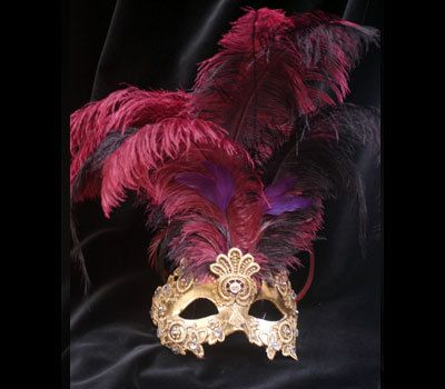 Traditional and original papier-mache Venetian mask, handmade and decorated with gold-leaf, trimmings, plumes. All our masks are handmade
