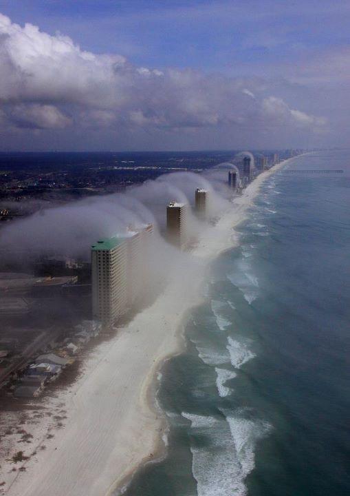 fog rolling over condo's on the Florida coast..