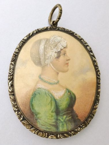 This regency lady is wearing two necklaces