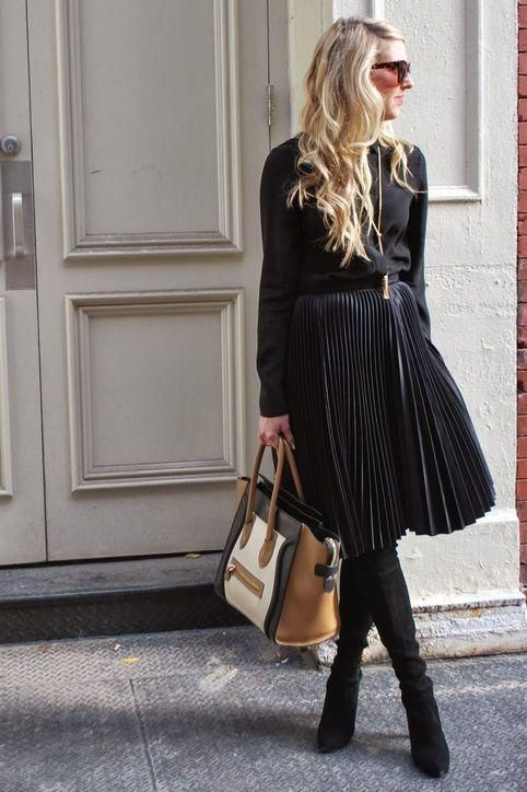 How to wear over-the-knee boots: Try them with a midi skirt so zero skin is actually showing. Click for more outfit ideas we love!