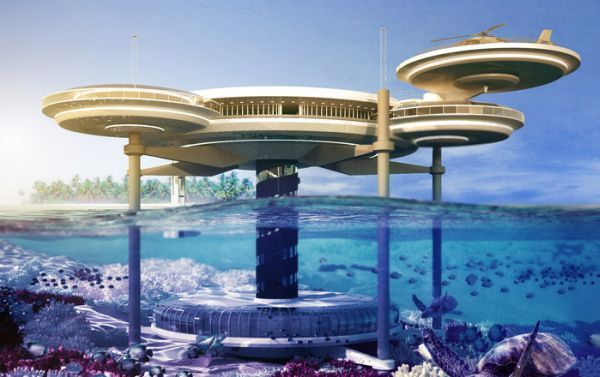 "The Dubai Water Discus Hotel;     part spaceship, part underwater odyssey. ""The phenomenal structure consists of two discs; one built above the water level while the other one located 10 meters below the surface. Three perpendicular pillars run through the two discs and are linked by a fourth assembly that accommodates the elevator and staircase"". The hotel also has a diving school and bedrooms have a scenic view of the ocean; either from above or below."