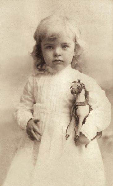 Vintage Photograph - Little one with her toy horse     Makes me think of Merritt, Lord Westcliff and Lillian's daughter, from Mine Till Midnight by Lisa Kleypas, part of the Hathaway series.