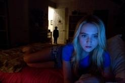 "Recycled plot haunts ""Paranormal Activity 4."" Alex (Kathryn Newton) notes something amiss when her family takes in a neighbor boy in ""Paranormal Activity 4."""